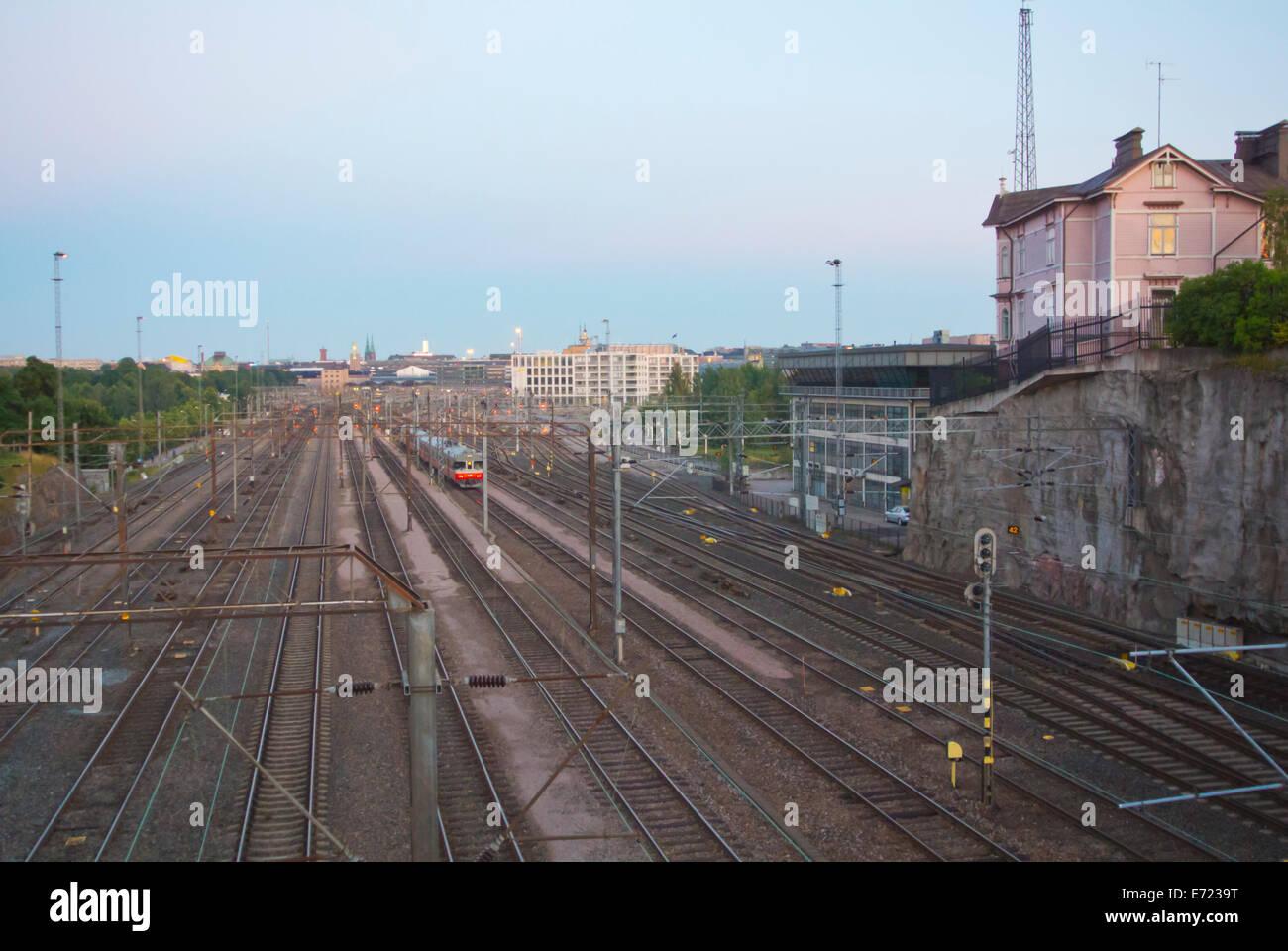 Railway tracks leading to railway station, Helsinki, Finland, Europe - Stock Image
