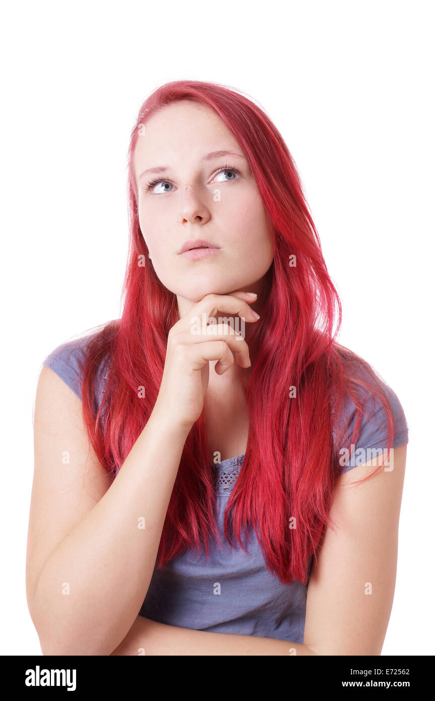 young woman looking up thinking - Stock Image