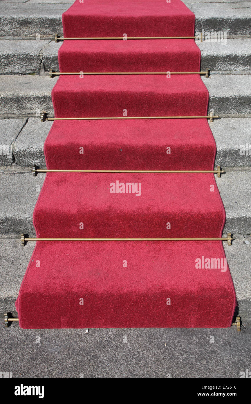 A red carpet laid out on stairs - Stock Image