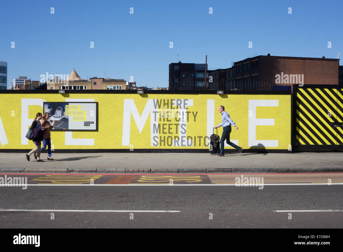 Advertising hoardings in the city of London and Shoreditch, England, UK - Stock Image