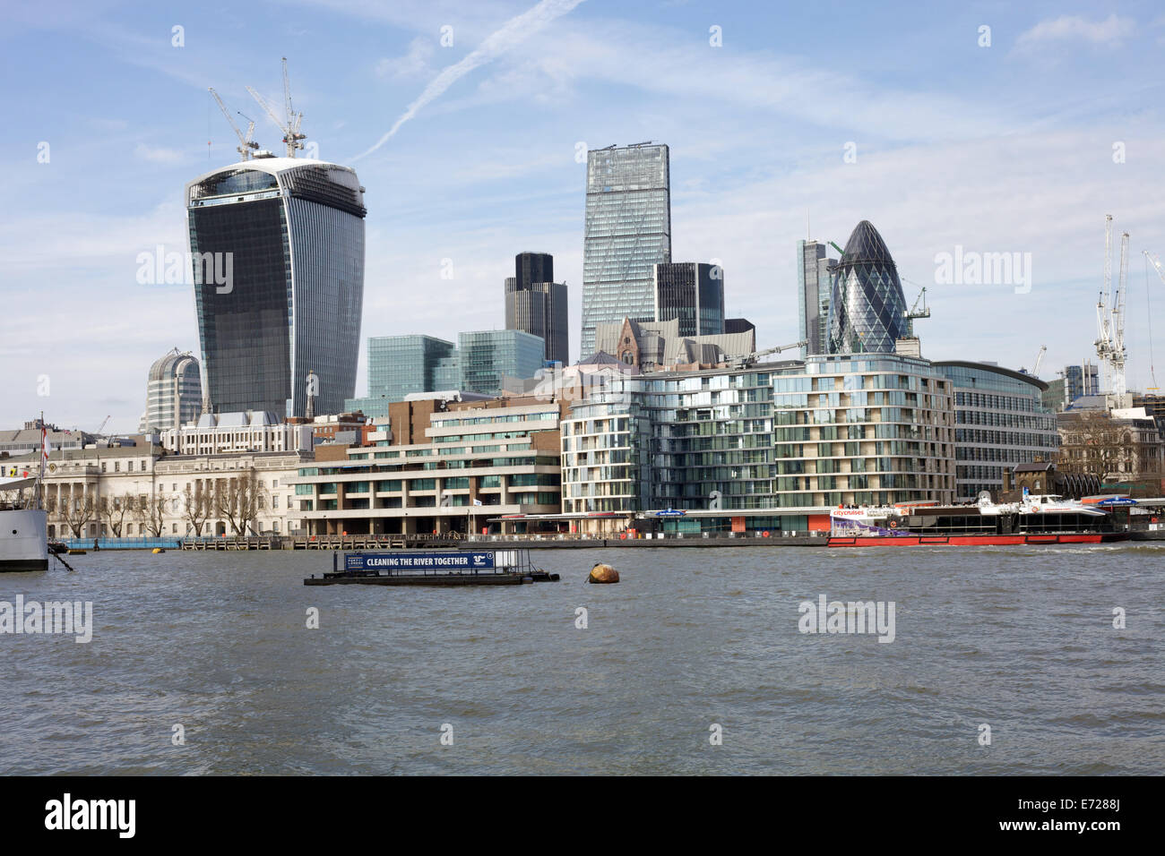 The city of London viewed from the south side of the River Thames. - Stock Image