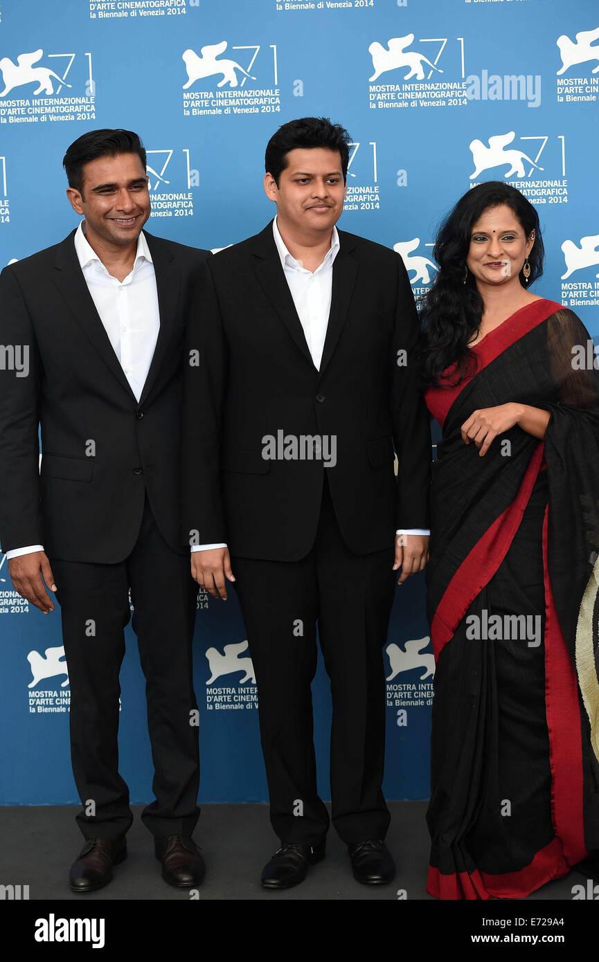 Venice, Italy. 4th Sep, 2014. Actor Vivek Gomber, director Chaitanya Tamhane and actress Geetanjali Kulkarni (from - Stock Image
