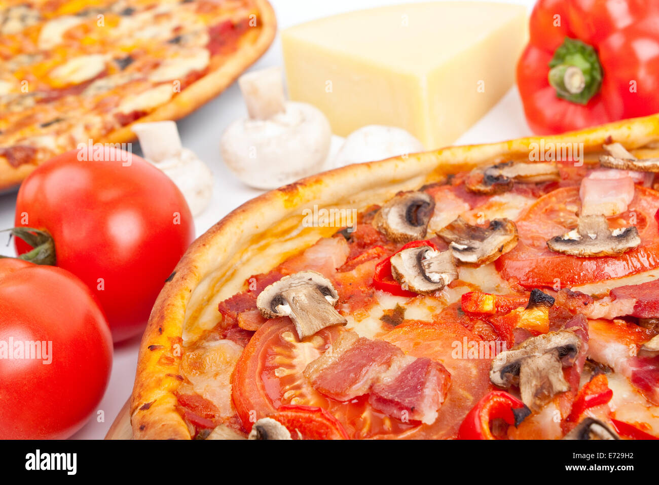 ham and mushroom pizza with ingredients - Stock Image