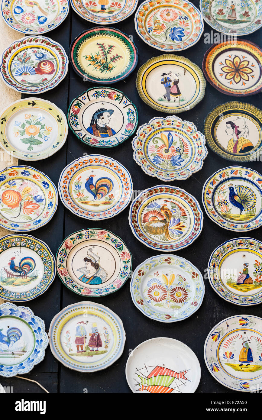 Faience ware, typical painted earthenware plates, Quimper, Brittany, France - Stock Image