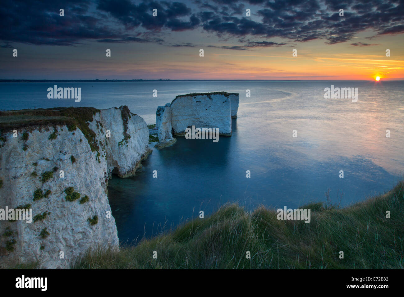 Sunrise over The white cliffs and Harry Rocks at Studland, Isle of Purbeck, Jurassic Coast, Dorset, England - Stock Image