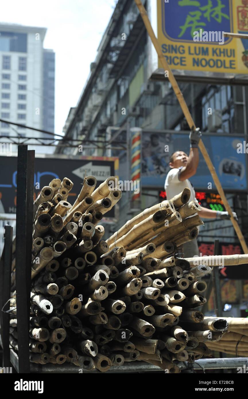 Bamboo poles, awaiting use in construction of scaffolding, Kowloon, Hong Kong, China - Stock Image