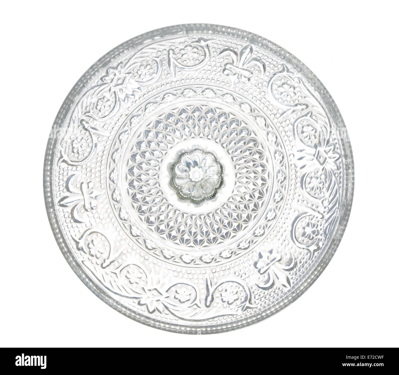 plate made of transparent glass with patterns, isolated on white background. - Stock Image
