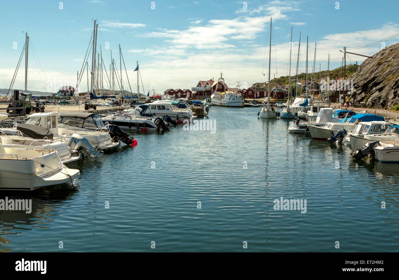 Moored boats in the southern port on the island of Stora Dyrön, Bohuslän, Västra Götaland County, Sweden. Stock Photo