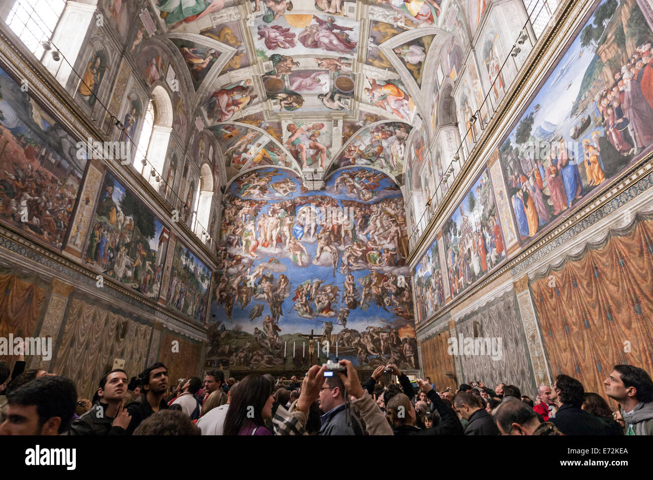 87f5cc53e821 Tourist taking pictures to The Creation of Adam by Michelangelo Sistine  Chapel ceiling.