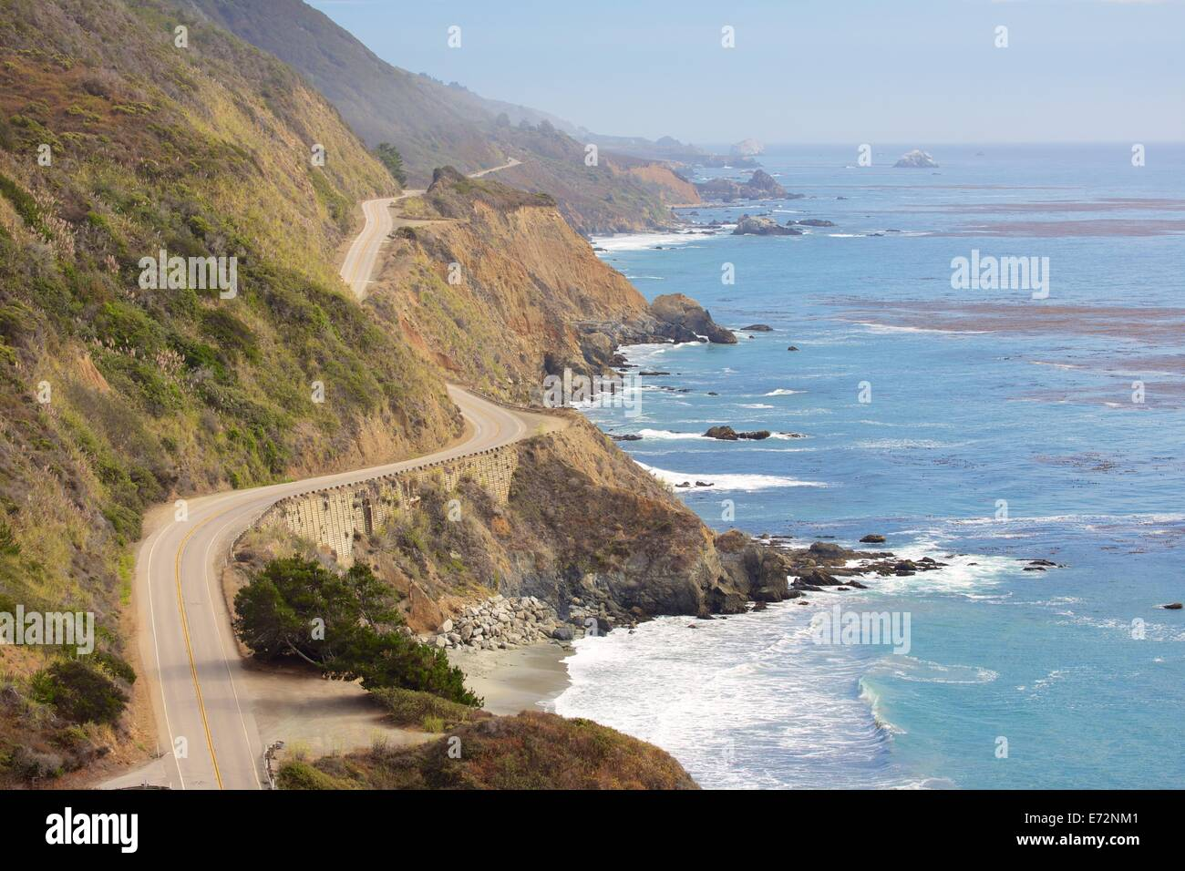 Famous Highway One winds along the cliffs of Big Sur California next to the Pacific Ocean - Stock Image