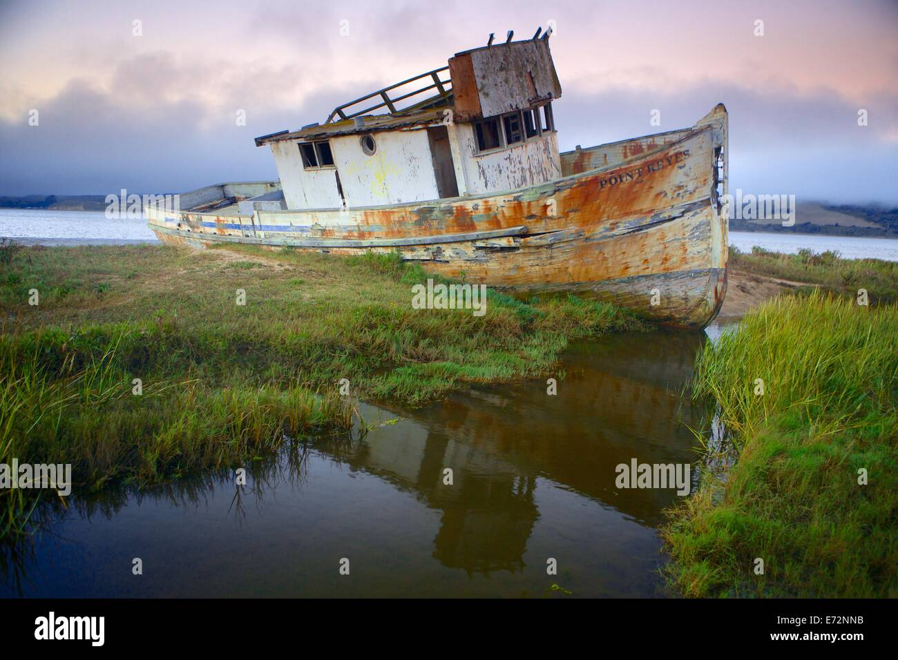 The Point Reyes has seen more seaworthy days, but she is still a beauty. Taken at sunset with beautiful low fog. - Stock Image