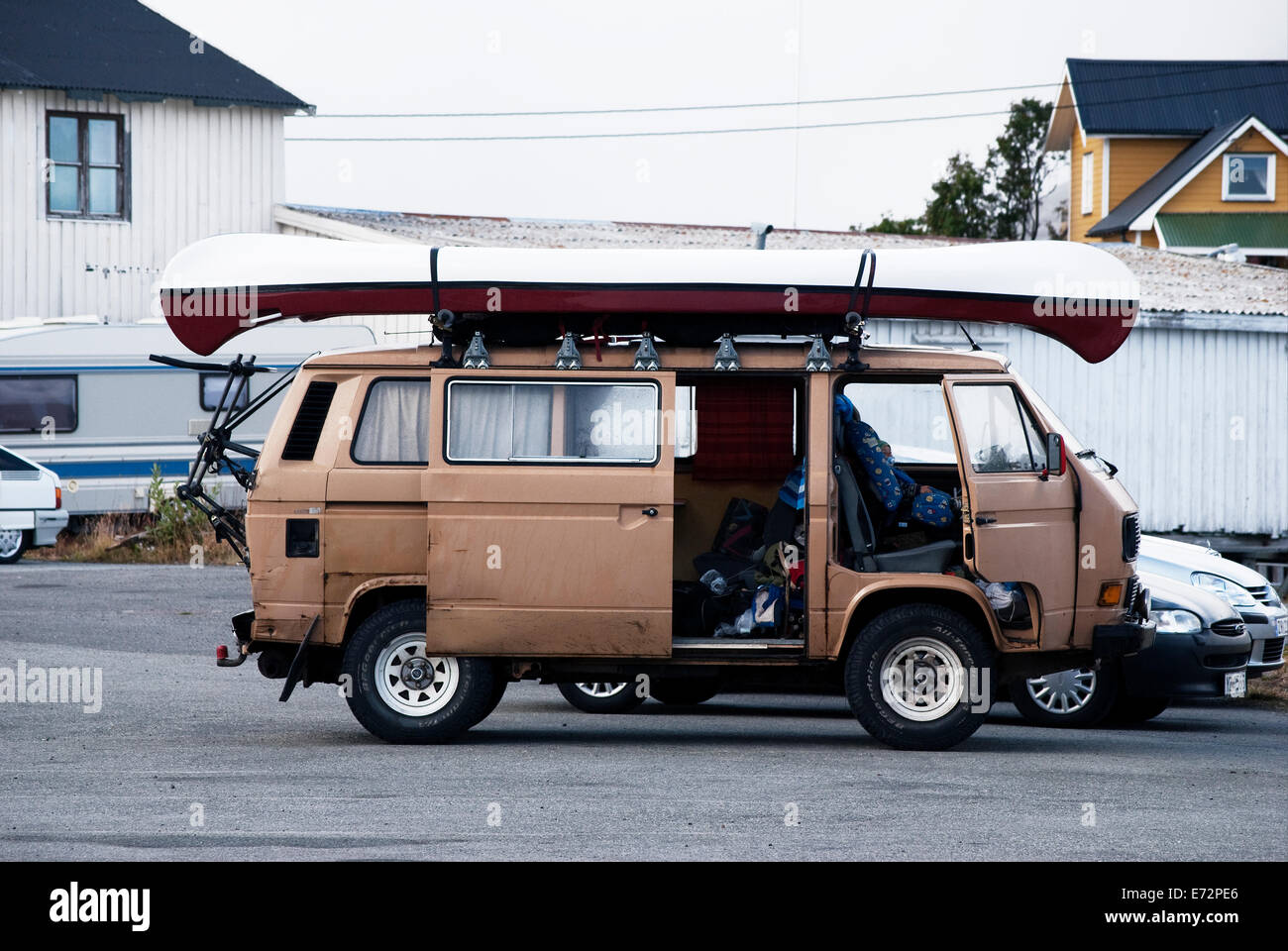 Classic vw camper - caravan with kayak on the roof. - Stock Image