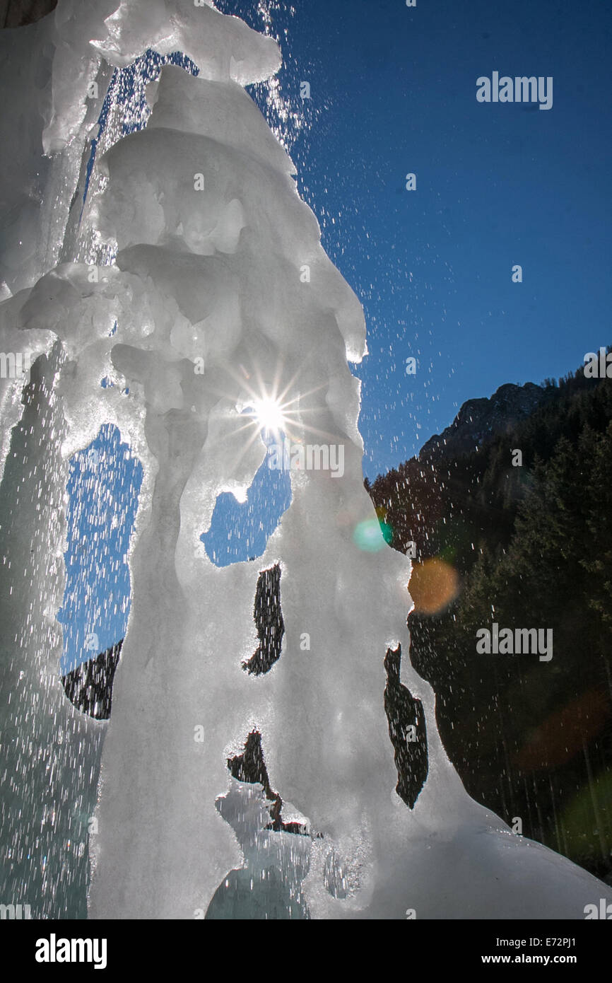 waterfall of ice that melts in the spring - Stock Image
