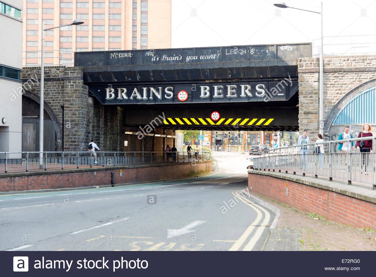 Railway bridge advertising Brains Beers in Cardiff, Wales, UK. - Stock Image