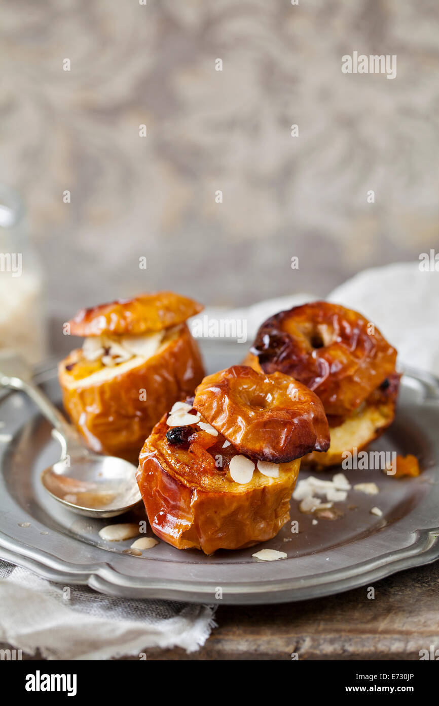 Baked apples stuffed with raisins and apricots - Stock Image