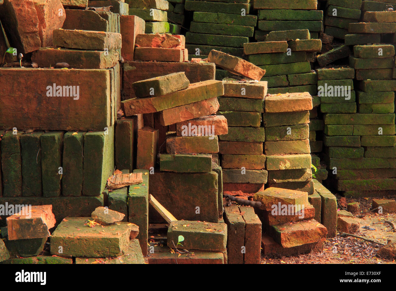 stack of old red bricks , humid bricks - Stock Image
