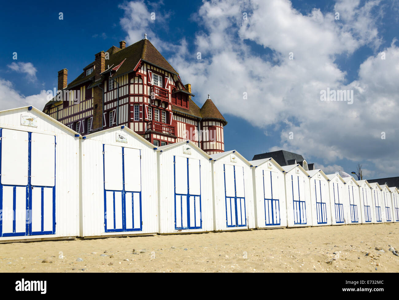 White Beach Cabins In A Row On French Coast With A Beautiful