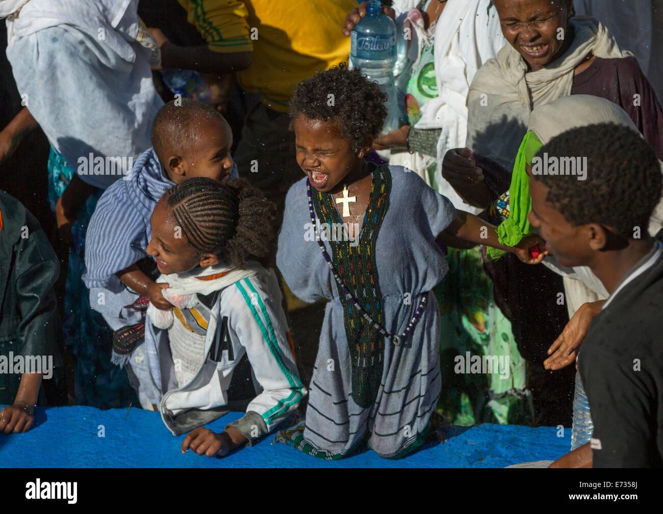 Holy Water Sprayed Onto The Crowd Attending Timkat Celebrations Of Epiphany, Lalibela, Ethiopia - Stock Image