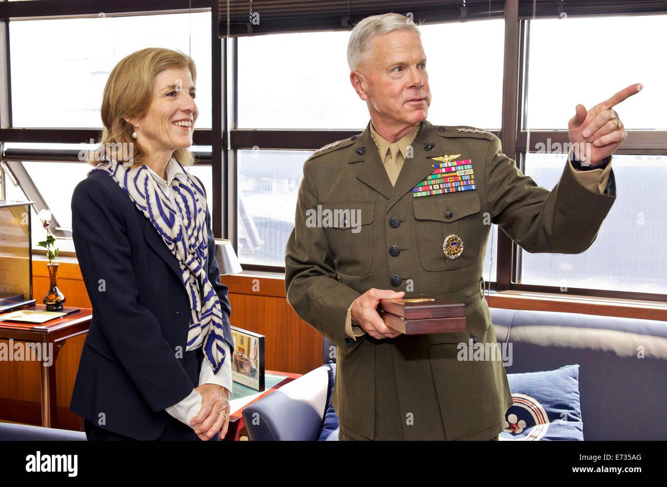 Commandant of the U.S. Marine Corps Gen. James F. Amos speaks with U.S. Ambassador to Japan Caroline Kennedy during - Stock Image