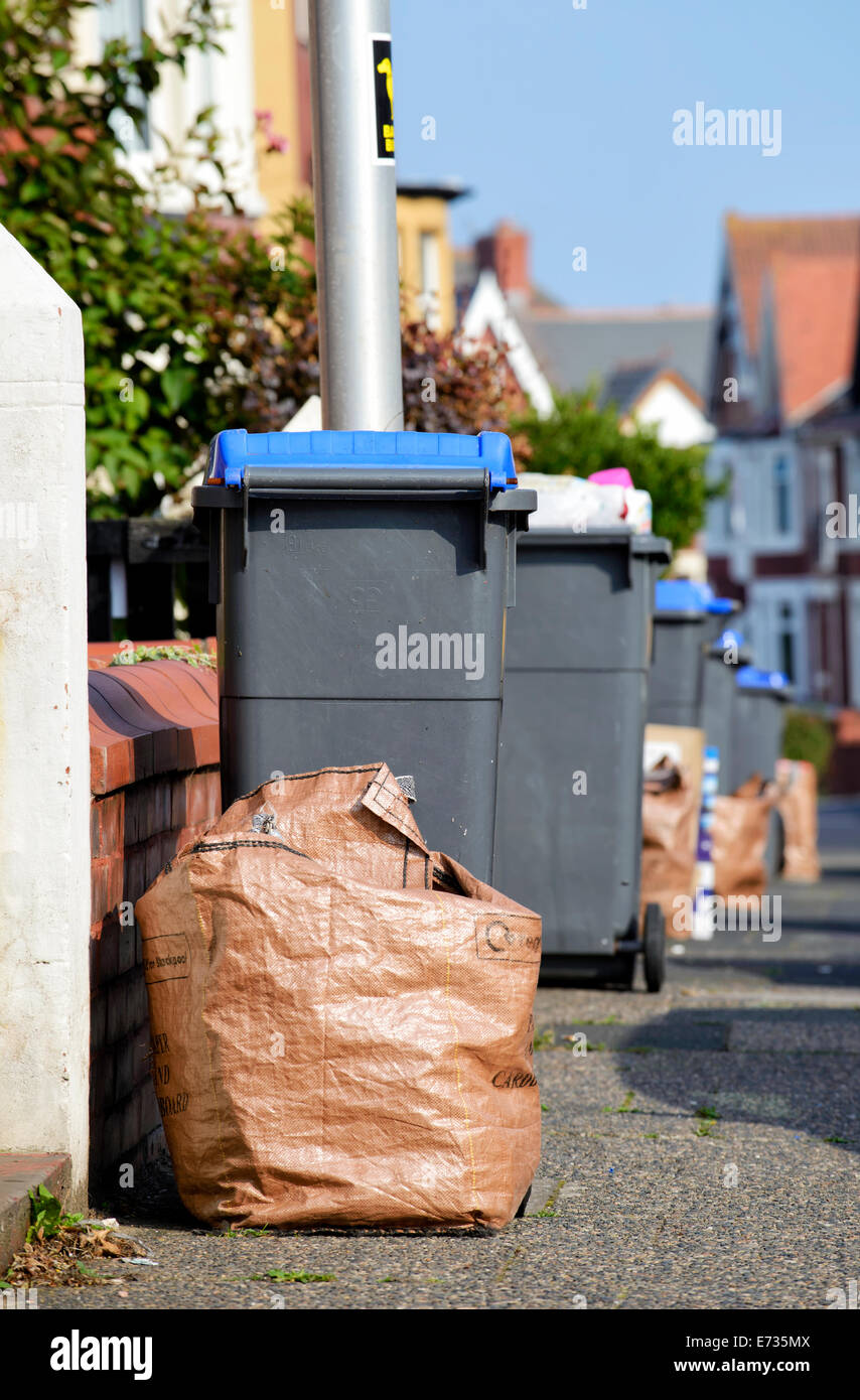 Wheelie bins containing glass and plastics and brown sacks with paper and cardboard, awaiting collection by Blackpool - Stock Image