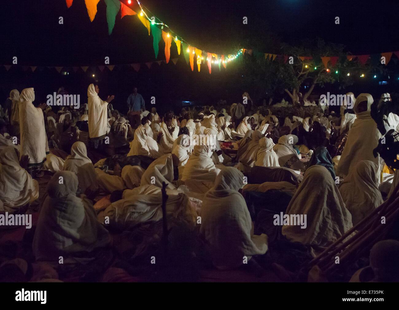 Orthodox Pilgrims At Timkat Festival During Nightime, Lalibela, Ethiopia Stock Photo