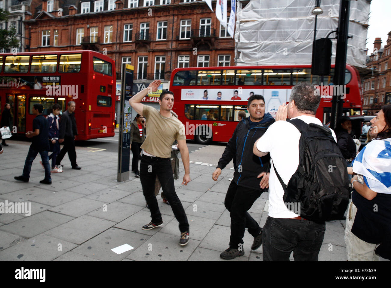 Oxford Street, London, UK, 4th September, 2014. Two men walking past pro-Israel counter protest to the boycott of - Stock Image