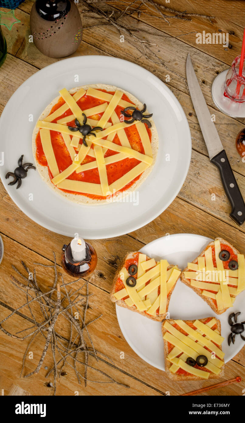 spooky halloween snacks set up on a wooden table stock image