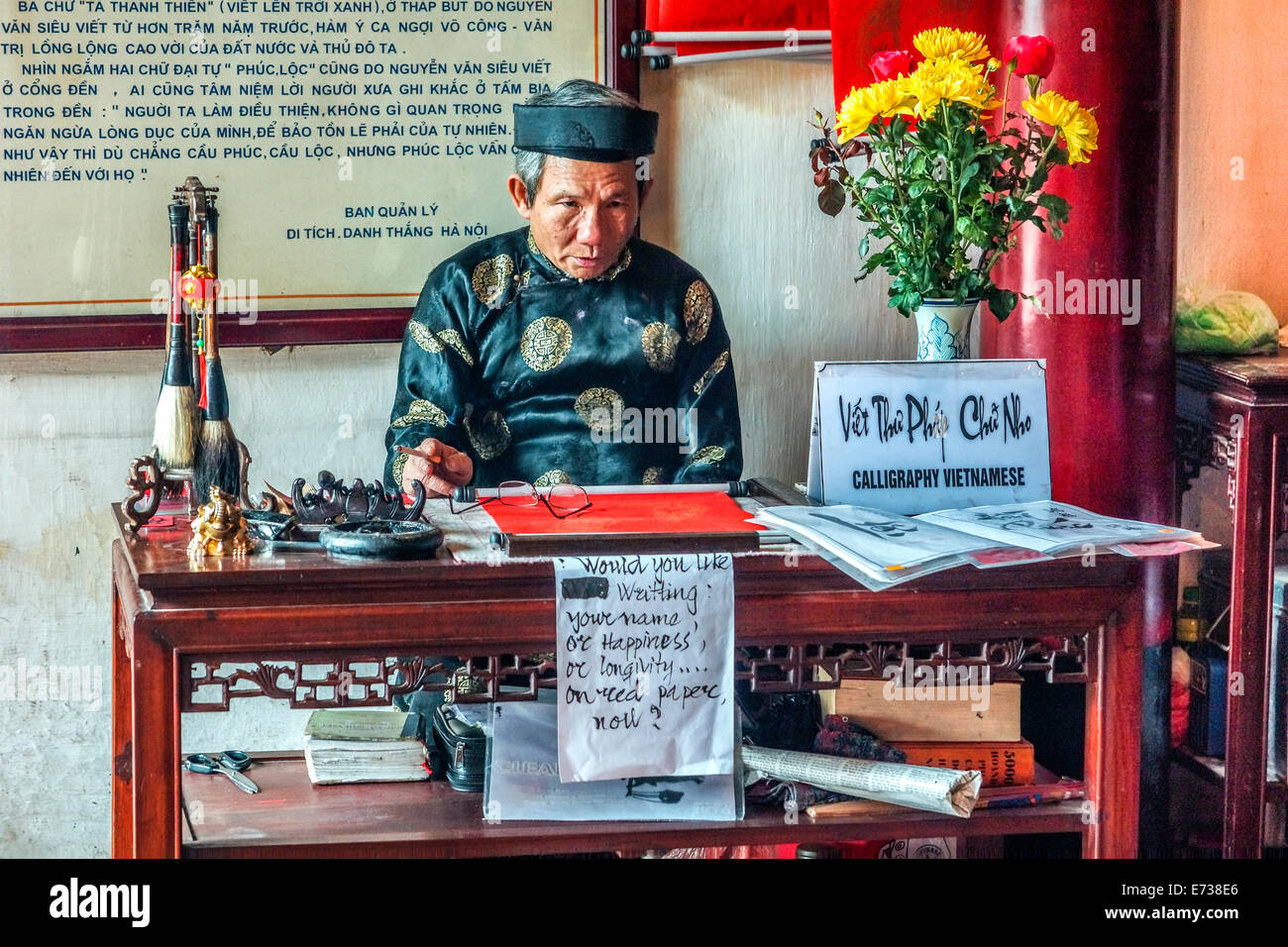 Old man offers calligraphy in Ngoc Son temple. - Stock Image