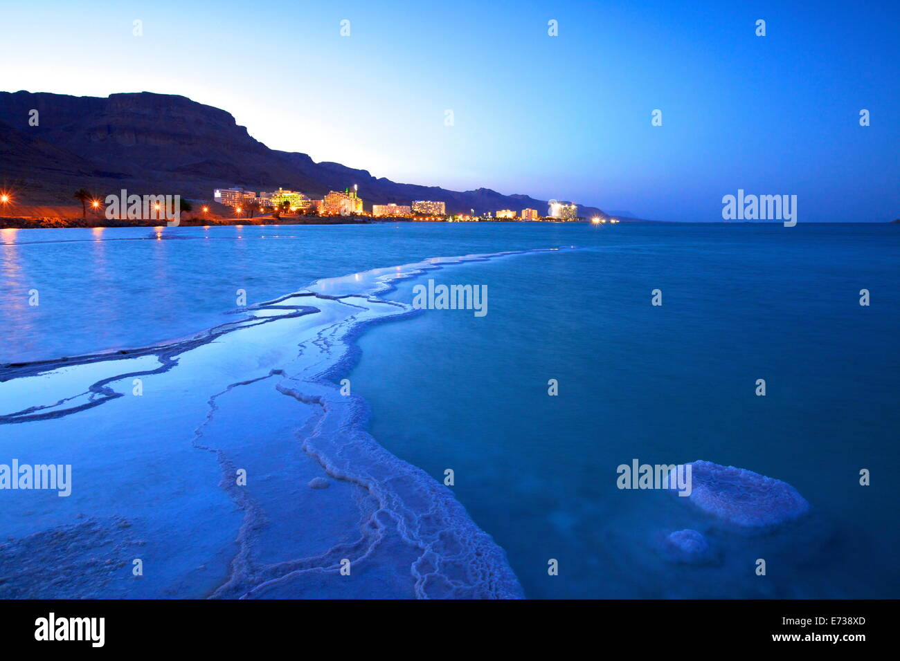 Salt deposit in foreground looking towards Ein Bokek, Ein Bokek, Dead Sea, Israel, Middle East - Stock Image