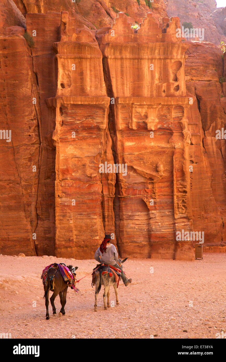 Bedouin riding donkey in the Siq, Petra, UNESCO World Heritage Site, Jordan, Middle East - Stock Image