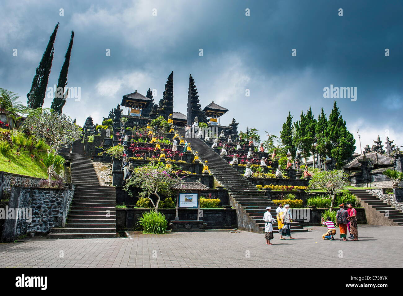 Stone statues with colourful capes in the Pura Besakih temple complex, Bali, Indonesia, Southeast Asia, Asia - Stock Image