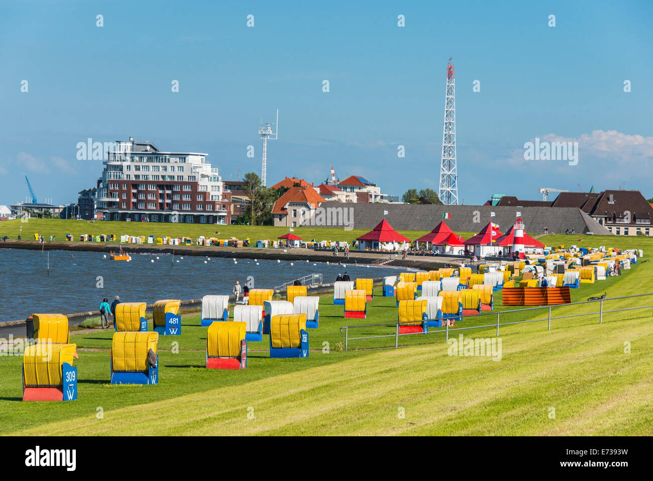Colourful beach chairs on the beach of Cuxhaven, Lower Saxony, Germany, Europe - Stock Image