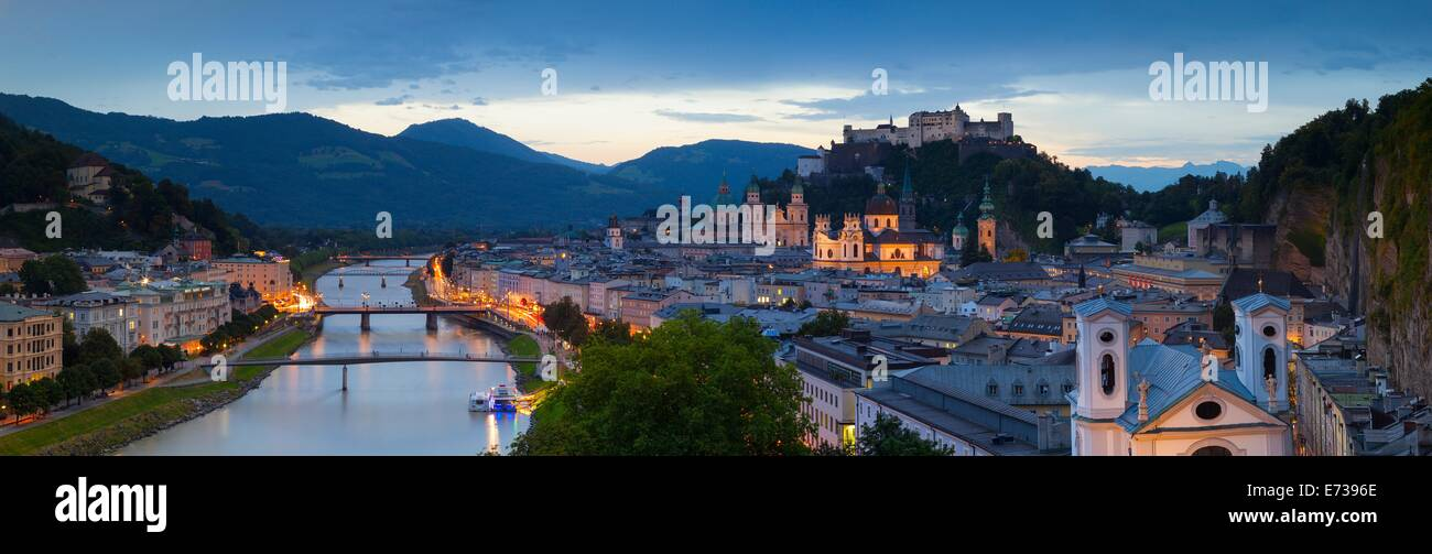 Hohensalzburg Fortress and Alt Stadt illuminated at dusk, Salzburg, Salzburger Land, Austria, Europe - Stock Image