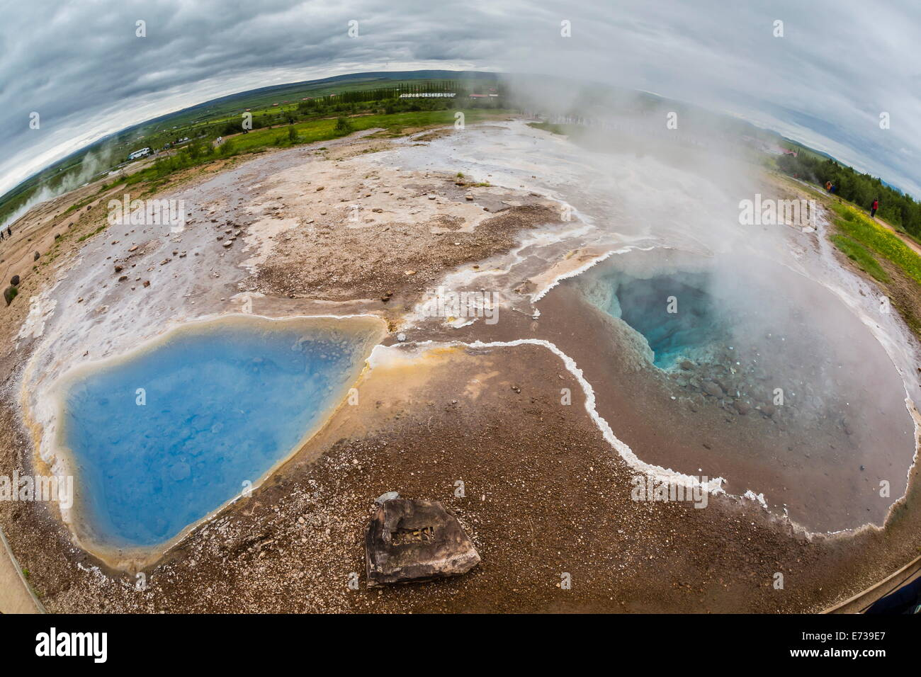 View of hot springs in the Haukadalur valley on the slopes of Laugarfjall hill, Iceland, Polar Regions Stock Photo