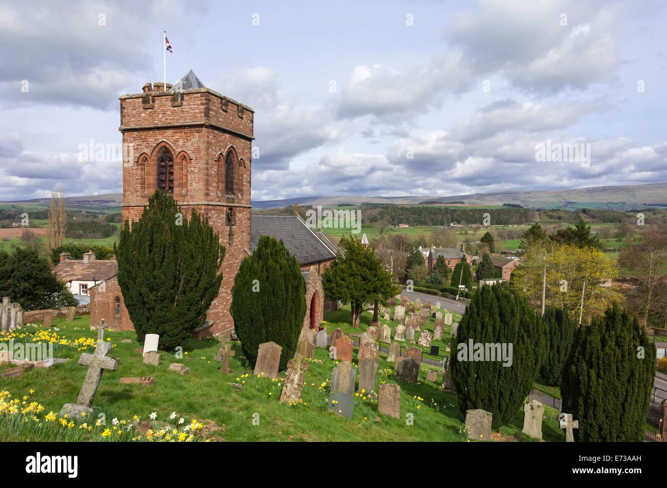 St. Nicholas Church, Crucifixion Window by Mayer of Munich, Lazonby Village, Pennine Ridge beyond, Eden Valley, - Stock Image