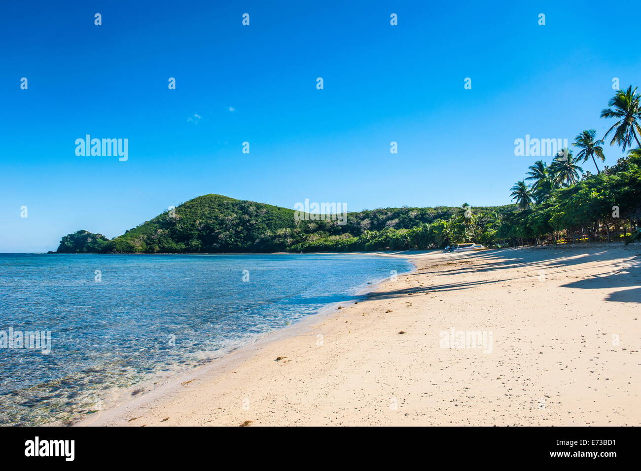White sandy beach on  Korovou Eco-Tour Resort, Naviti, Yasawas, Fiji, South Pacific, Pacific - Stock Image
