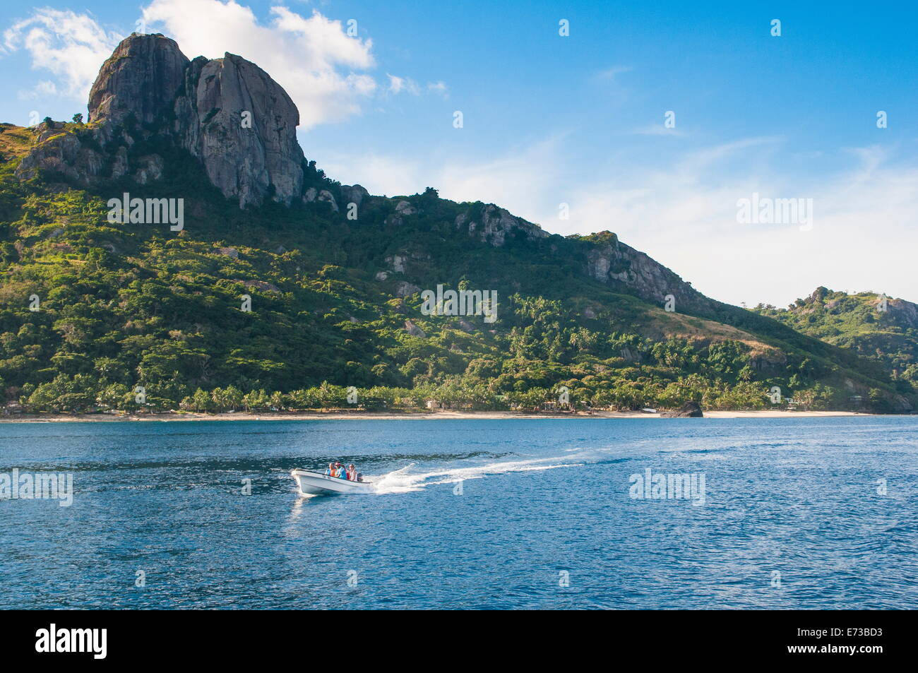 Little motorboat cruising before, Naviti island, Yasawas, Fiji, South Pacific, Pacific Stock Photo