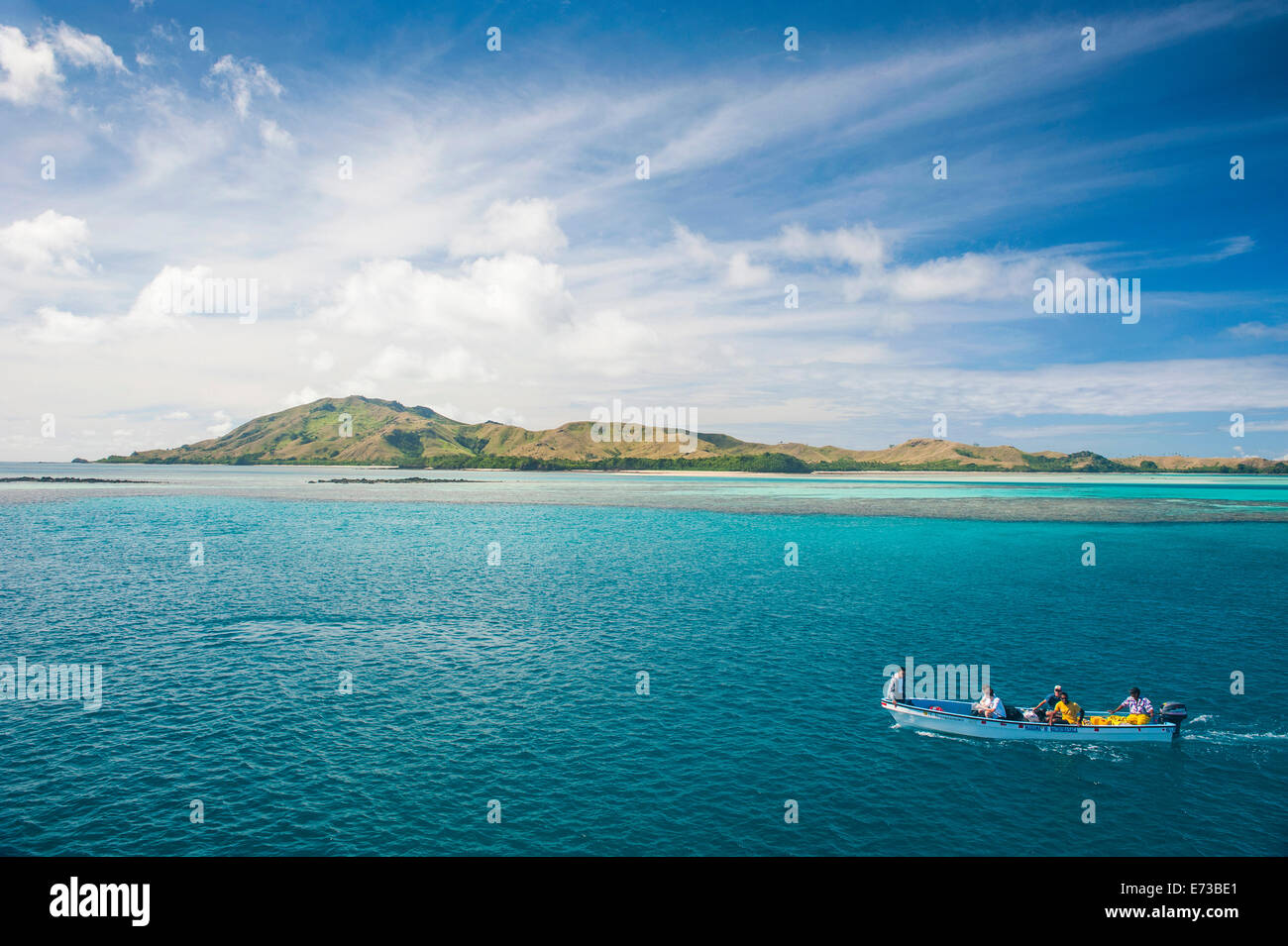 Little boat in the blue lagoon, Yasawas, Fiji, South Pacific, Pacific - Stock Image