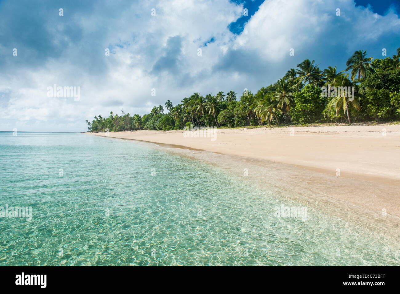 Palm fringed white sand beach in Haapai, Haapai Islands, Tonga, South Pacific, Pacific - Stock Image