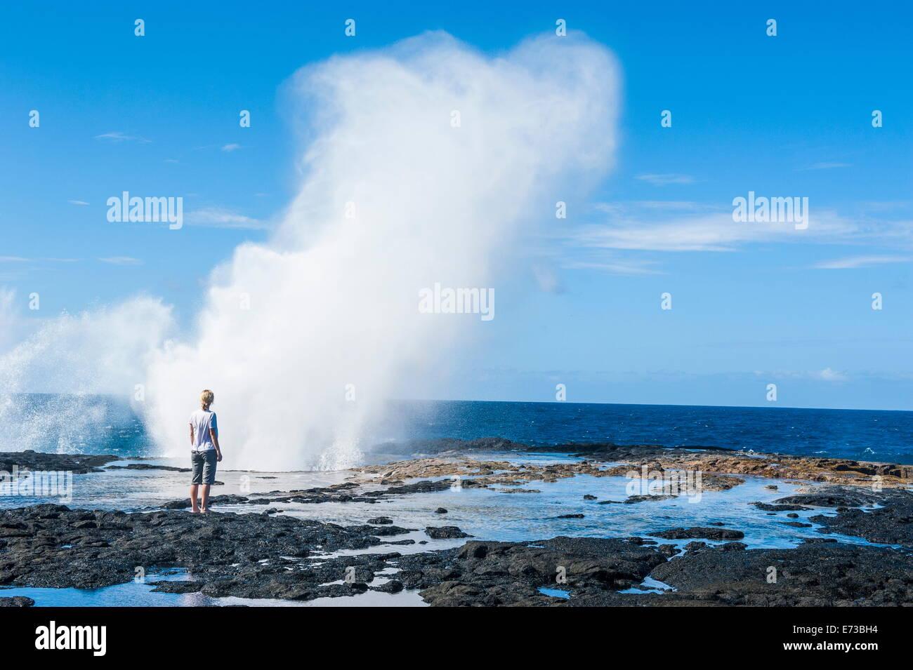 Tourist enjoying the huge waves in the Alofaaga blowholes on the south of Savaii, Samoa, South Pacific, Pacific - Stock Image