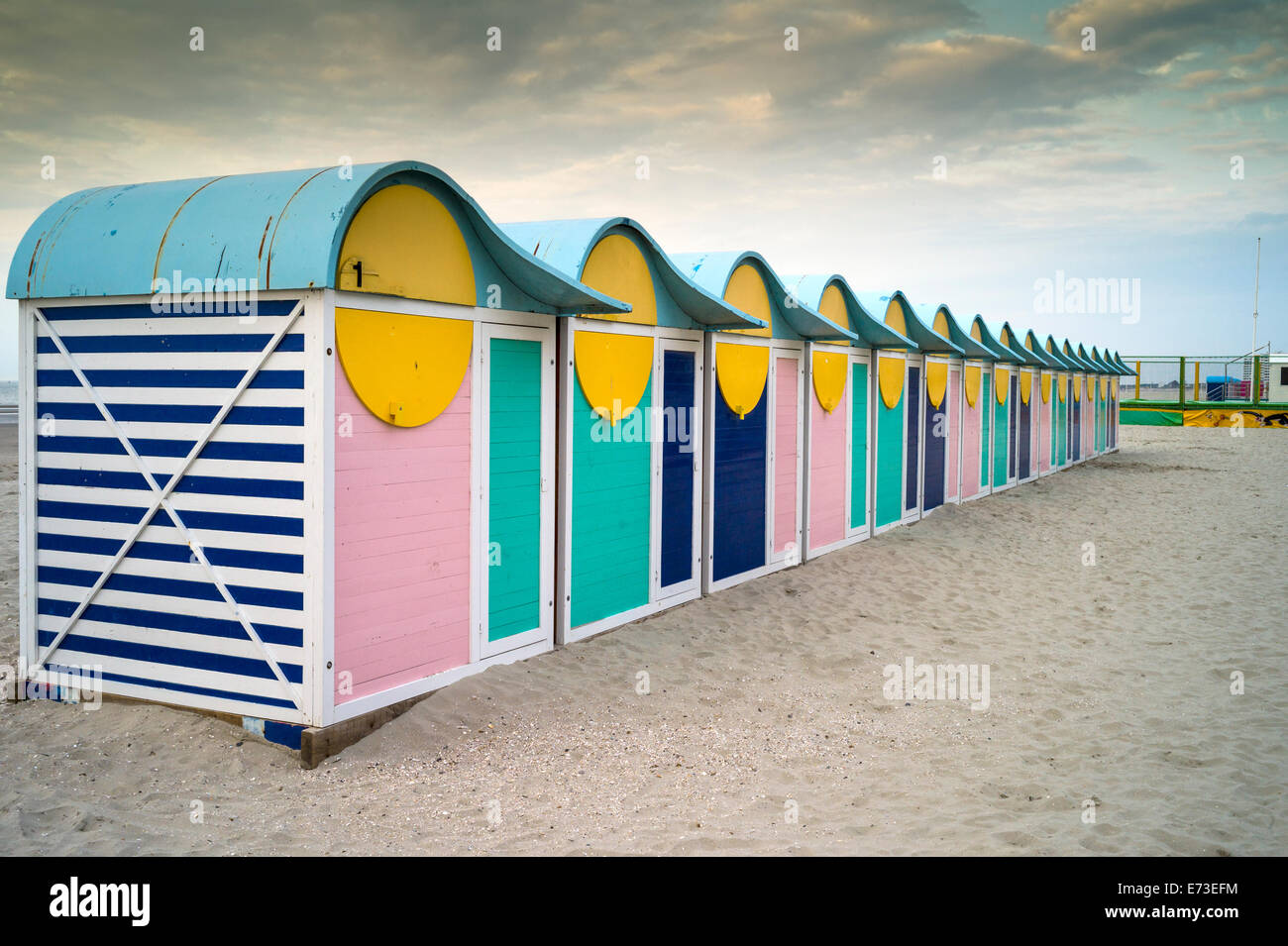 Brightly coloured Beach Huts Dunkirk Dunkerque Northern France as sunset - Stock Image