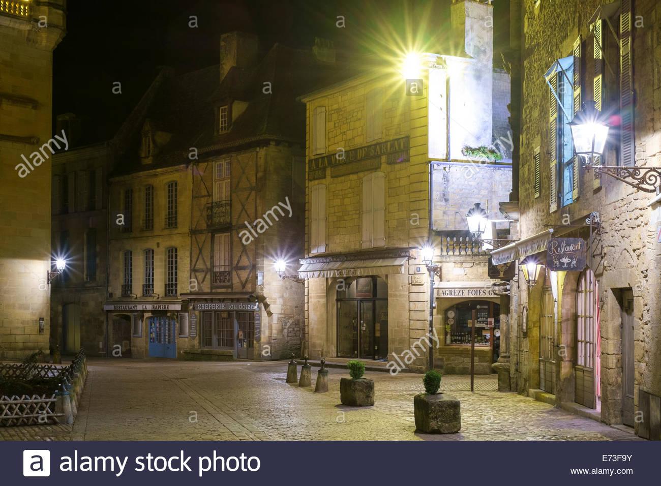 Old buildings on Place du Peyrou at night, Sarlat-la-Canéda, Dordogne Department, Aquitaine, France Stock Photo