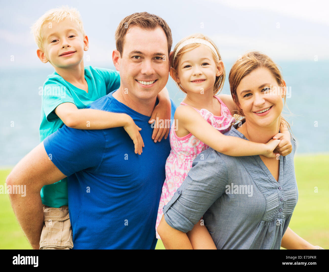 Portrait of Happy Family Outside - Stock Image