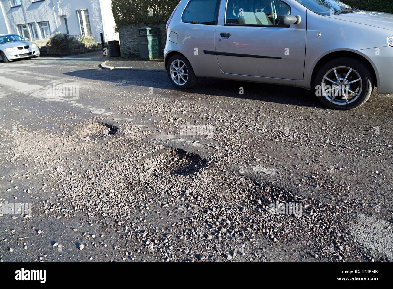 Pothole damage to road after floods, Llanfoist, Abergavenny, Wales, UK - Stock Image