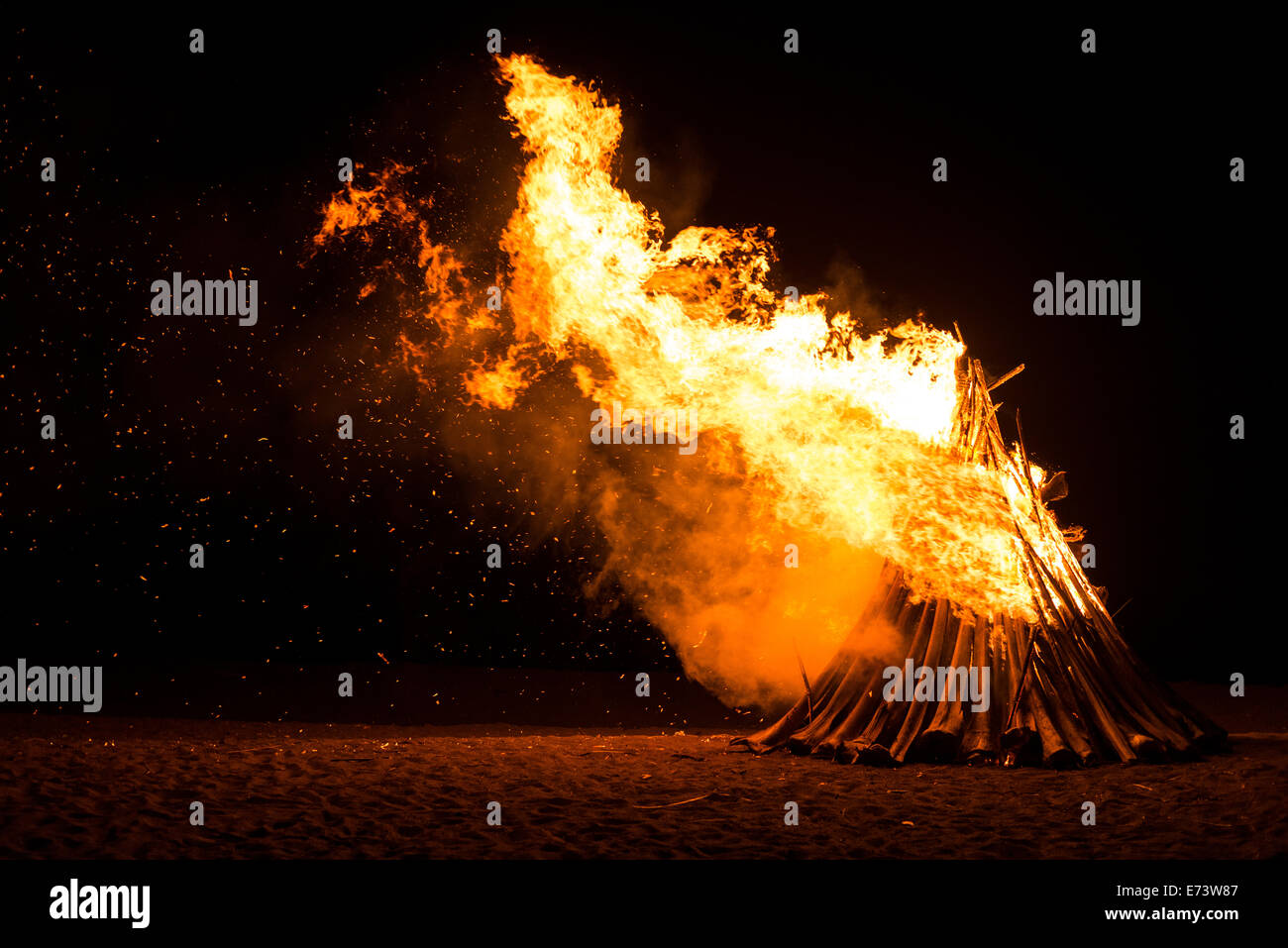 Blazing bonfire on the beach of a small island in the Philippines - Stock Image