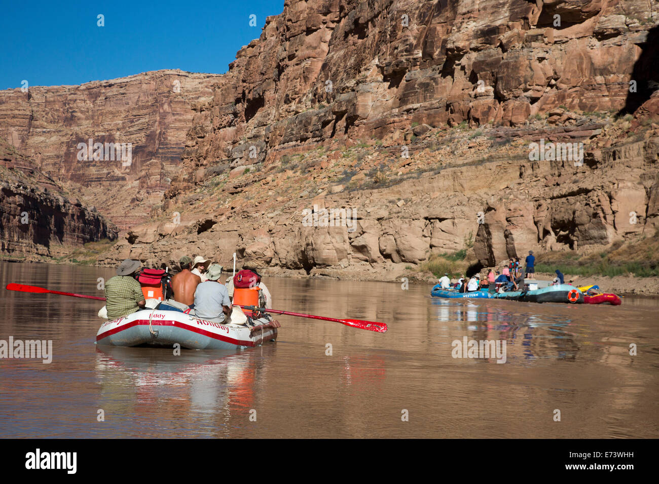 Canyonlands National Park, Utah - Motorized rafts (right) pass an oar boat on the Colorado River in Cataract Canyon - Stock Image