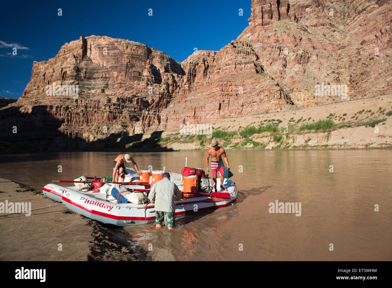 Canyonlands National Park, Utah - Raft guides secure equipment and supplies in rafts before leaving an overnight - Stock Image