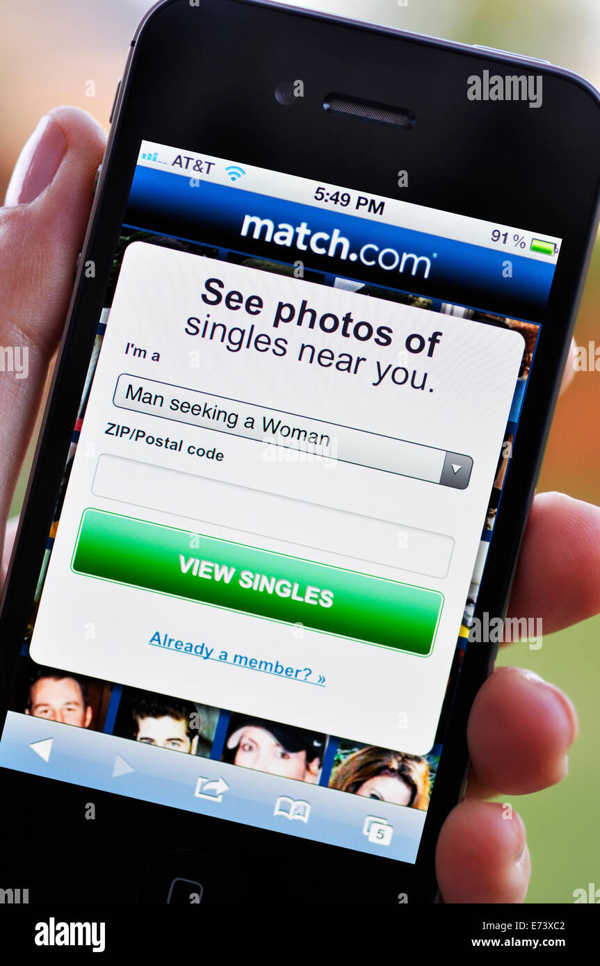 iPhone screen showing Match online dating website - Stock Image