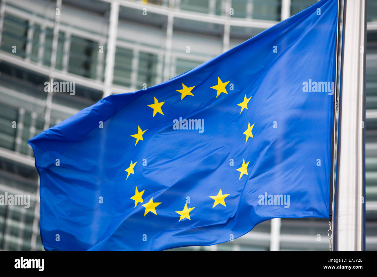 EU flag close up in front of Berlaymont building - Stock Image
