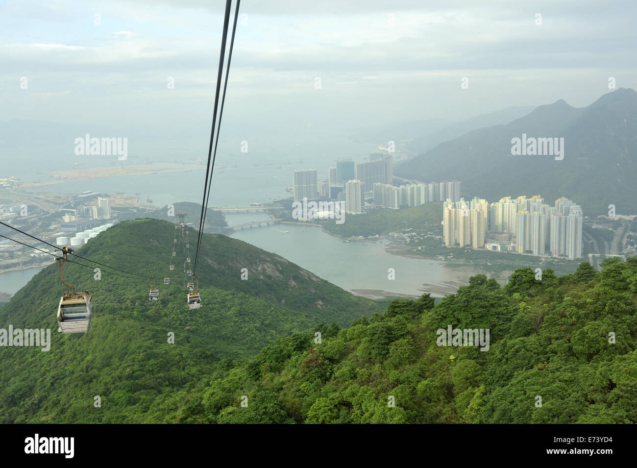 View from Ngong Ping 360 Cable Car chair lift, with Tung Chung (right) in distance - Stock Image